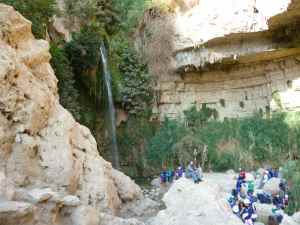 Doron seating in fron of Ein Gedi waterfall_