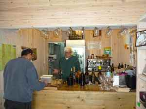 Eiton Green and the Mashgiach at Tzuba Winery's Wine tasting bar-small