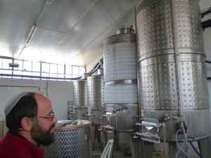 Yaacov Oryah and his Midbar Winery tanks-small