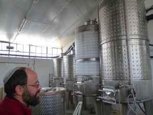 Yaacov Oryah and his Midbar Winery tanks-small