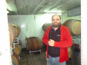 Yaacov Oryah in the barrel room o Midbar Winery-small
