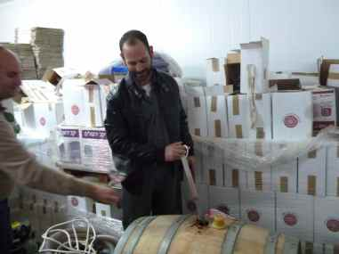 Nir taking port from Barrel in Har Bracha Barrel Room