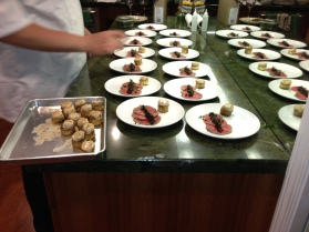 Setting the plates of Beef Carpaccio, Cherry Mostarda, Marrow Toast