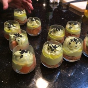 Course #2 Tomato Sorbet, Avacado Mousse, Black Salt, Pistachio oil - on table