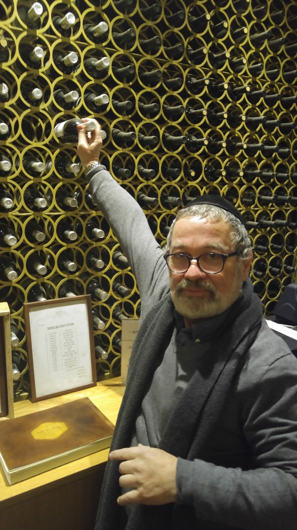 pierre-miodownick-reaching-into-his-cellar-to-find-some-great-wines-to-enjoy